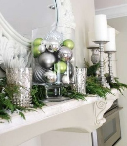 silver and green balls in clear glass vase